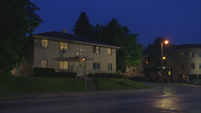 n/x brick 2 - story apartment building; lights on - flat stock videos & royalty-free footage