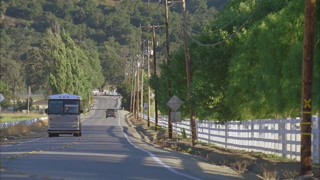 passenger bus r-b's, rural highway - wisconsin stock videos & royalty-free footage
