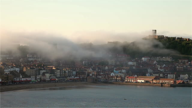 SOUTH BAY AND CASTLE IN FOG