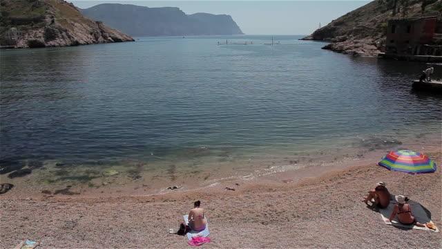 people sunbathing on beach - ukraine stock videos & royalty-free footage