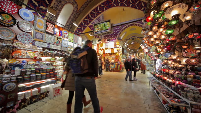 pottery and lighting stalls inside the grand bazaar - grand bazaar istanbul stock videos and b-roll footage