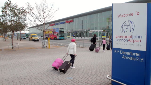 people walking at liverpool airport - liverpool england stock videos & royalty-free footage