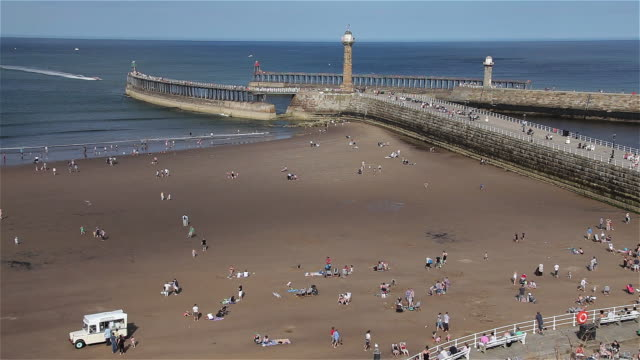 beach twin piers and entrance to harbour - whitby north yorkshire england stock videos & royalty-free footage