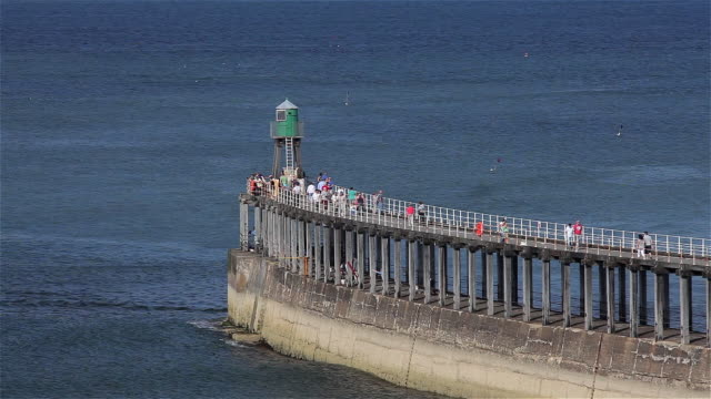 walking on west pier - whitby north yorkshire england stock videos & royalty-free footage