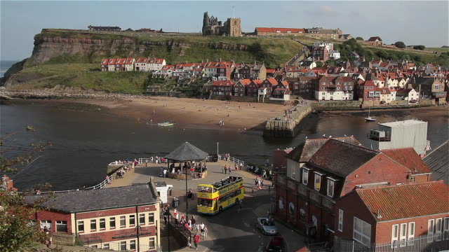 open topped bus east cliff and beach - yorkshire england stock videos & royalty-free footage