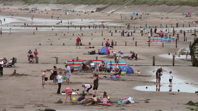 holiday makers on beach - whitby north yorkshire england stock videos & royalty-free footage
