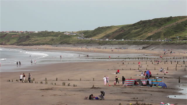 holiday makers on beach - england stock videos & royalty-free footage