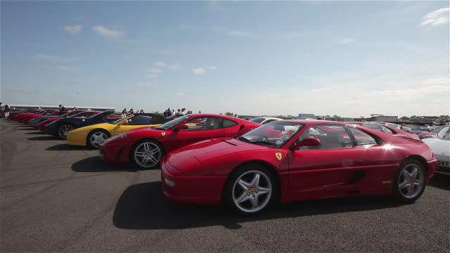 line of ferrari cars 430; silverstone race track, england - silverstone stock videos & royalty-free footage