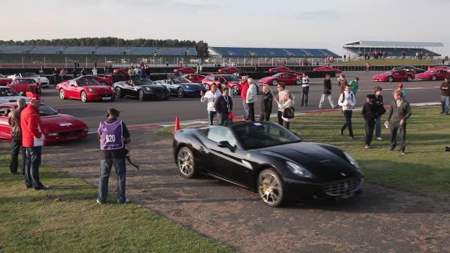 ferrari's move onto race track; silverstone, england - silverstone stock videos & royalty-free footage