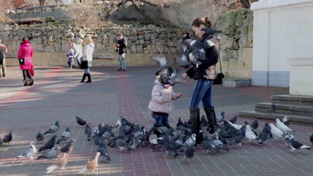 woman child feed pigeons sevastopol crimea ukraine - sevastopol crimea stock videos and b-roll footage