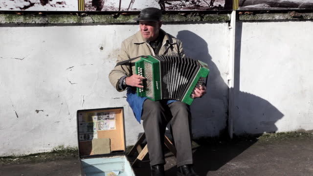 old man plays traditional song with accordion sevastopol crimea ukraine - sevastopol crimea stock videos and b-roll footage