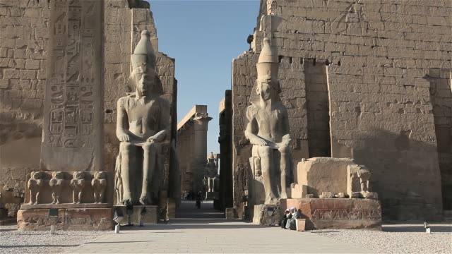 SEATED COLOSSI OF RAMSES AND OBELISK AT LUXOR TEMPLE