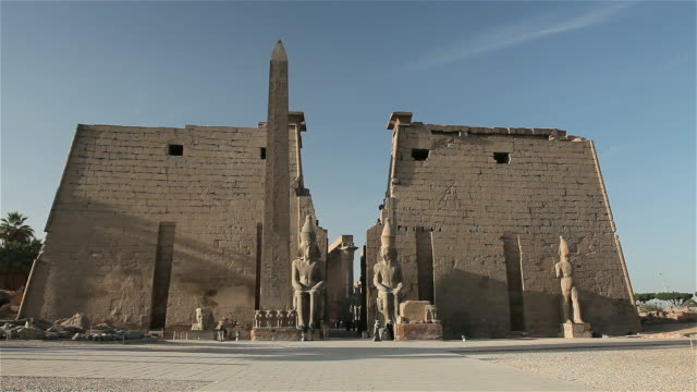 PINK GRANITE OBELISK AND FIRST PYLON OF LUXOR TEMPLE
