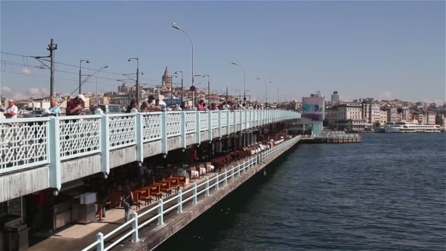 fisherman and galata bridge and tower - eminonu district stock videos and b-roll footage