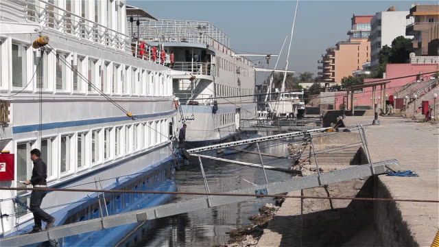 docked passenger cruise ships - luxor thebes stock videos & royalty-free footage