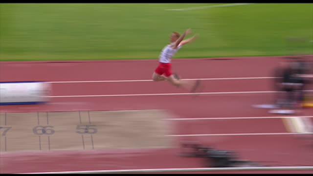nnbk748j - long jump stock videos & royalty-free footage