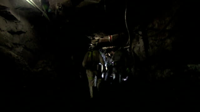 underground mining tunnel - minatore video stock e b–roll