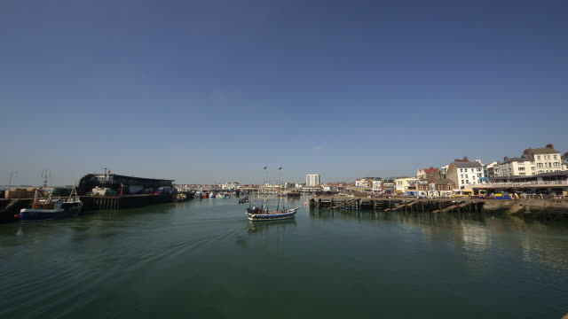 harbour fishing boats and pleasure boat rides - bridlington stock-videos und b-roll-filmmaterial