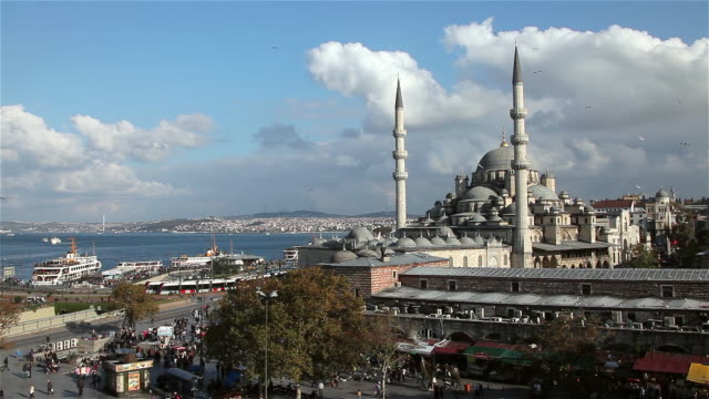 new mosque yeni cami and bosphorus - yeni cami mosque stock videos and b-roll footage