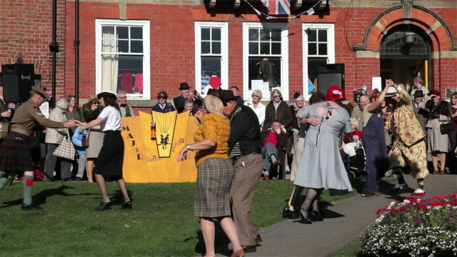 PEOPLE DANCING TO 1940S MUSIC