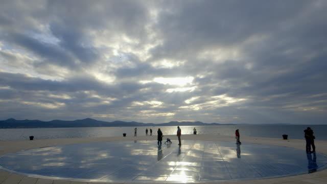 sun salutation on zadar quay - sun salutation stock videos & royalty-free footage