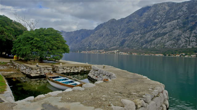 small boat moored in cove - perast stock videos and b-roll footage