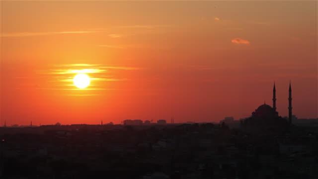 sunset near mosque - istanbul stock-videos und b-roll-filmmaterial