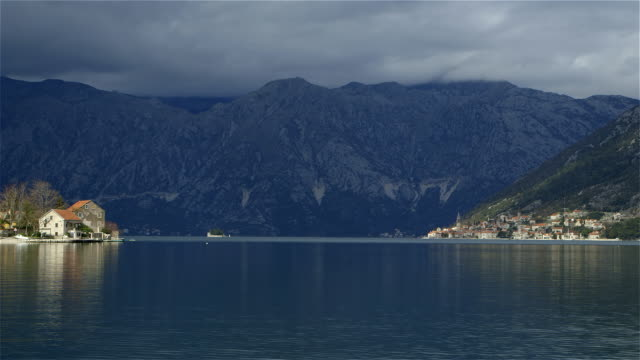 kotor bay perast town and mountain range - perast stock videos and b-roll footage
