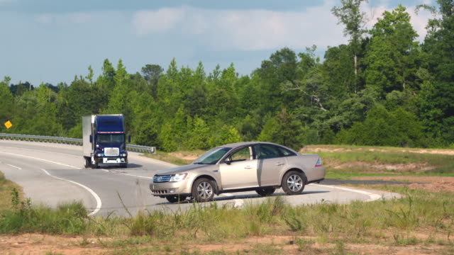 stalled car on highway destroyed by semi; slo mo - vehicle breakdown stock videos & royalty-free footage
