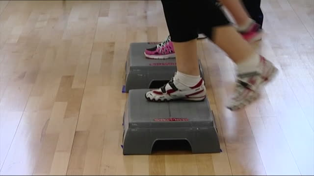nnbs328f - step aerobics stock videos and b-roll footage