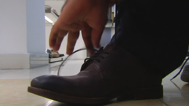 abla583a bbc world news - shoelace stock videos and b-roll footage
