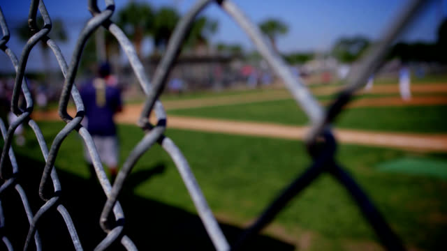 baseball game background thru fence - fence stock videos & royalty-free footage