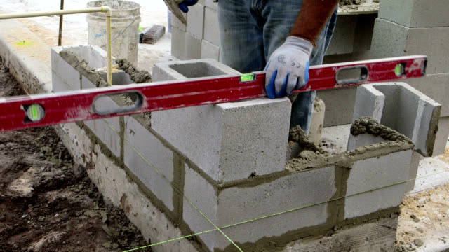 construction site-cinder blocks - block shape stock videos & royalty-free footage