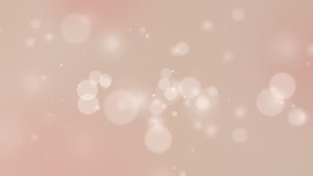 vídeos de stock e filmes b-roll de partícula creme de rosa suaves circulares - tan