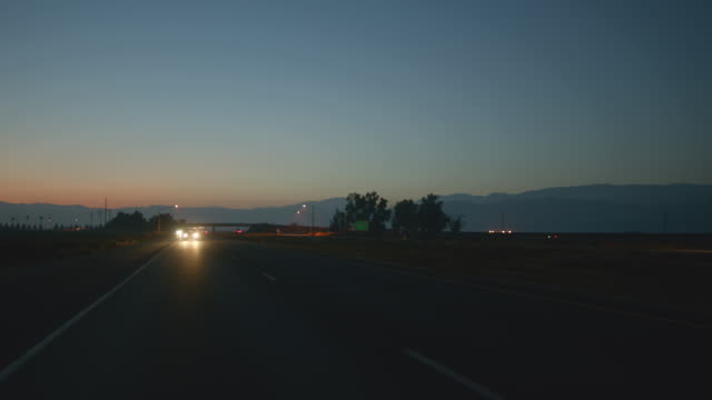 n/x (early evening) process straight back divided highway  - headlight stock videos & royalty-free footage