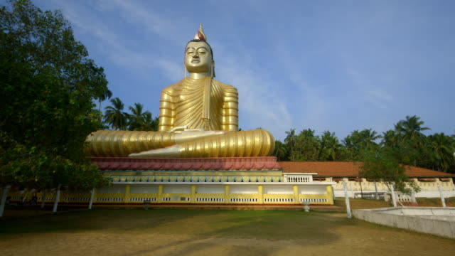 large seated buddha - sri lankan culture stock videos & royalty-free footage