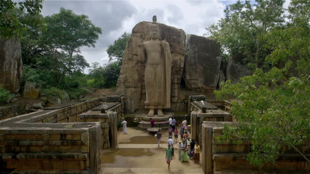 aukana buddha statue and tourists - sri lankan culture stock videos & royalty-free footage