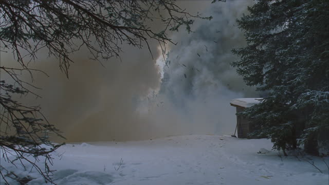 small cabin in snowy pine forest explodes; snowing - pine stock videos & royalty-free footage