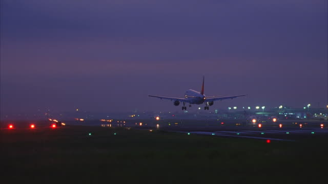 n/x passenger jet landings, manila, phillipines airport - south east asia stock videos & royalty-free footage