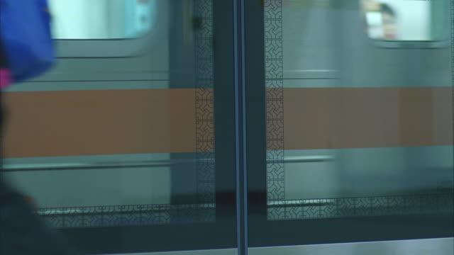 int. seoul, south korea subway station; train arrives l-r - korea stock videos & royalty-free footage