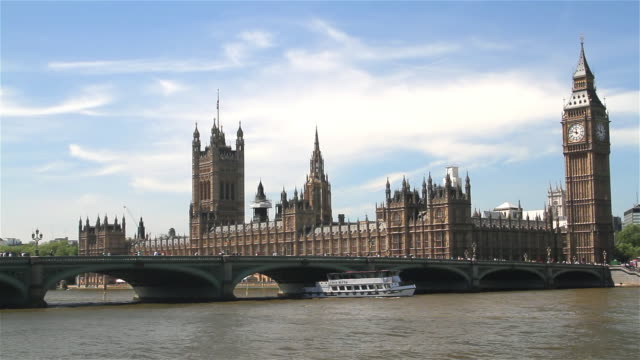houses of parliament and westminster bridge - westminster bridge stock videos and b-roll footage