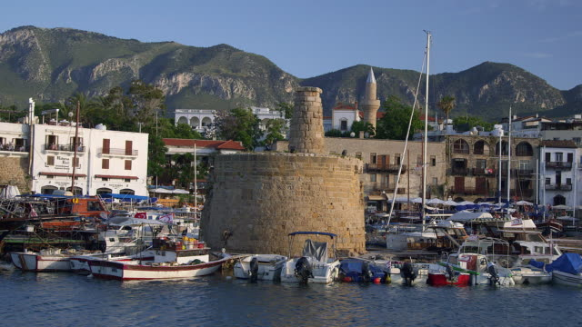 stockvideo's en b-roll-footage met boats in harbour and castle walls - repubiek cyprus