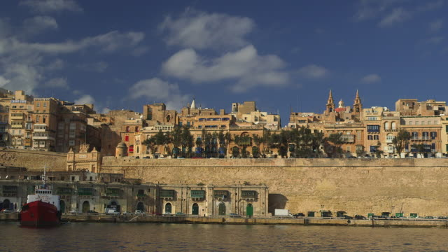 stockvideo's en b-roll-footage met quary wharf and red ship - valletta