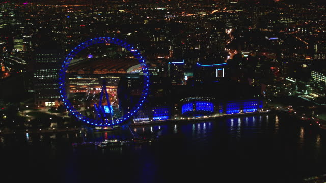 n/x aerial london circling london eye - fluss themse stock-videos und b-roll-filmmaterial