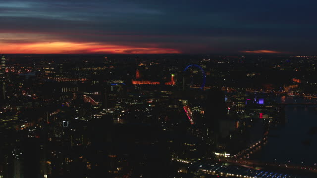 magic hour aerial london; fly around london eye - big wheel stock videos & royalty-free footage