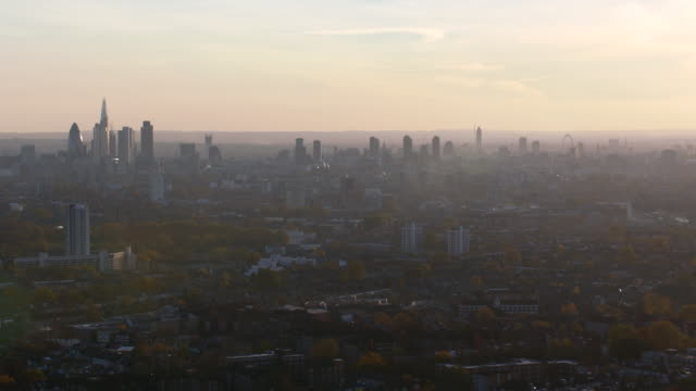 aerial london from lockwood reservoir, docklands toward city skyline - fog stock videos & royalty-free footage