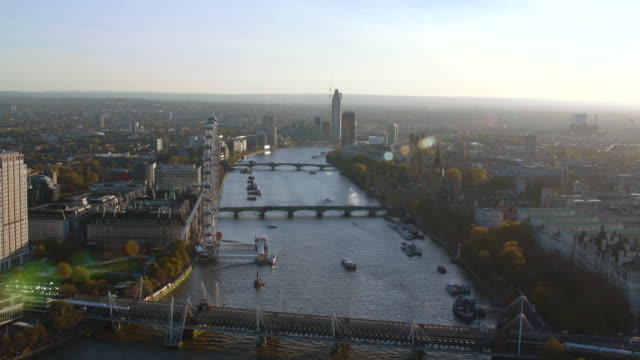 aerial london over thames river and to battersea power station - big wheel stock videos & royalty-free footage