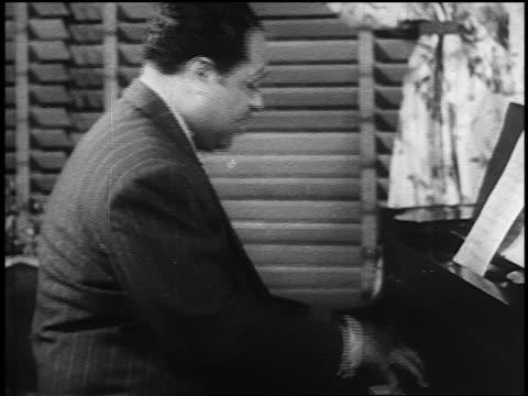 b/w 1930s profile duke ellington playing piano near window - jazz stock videos & royalty-free footage