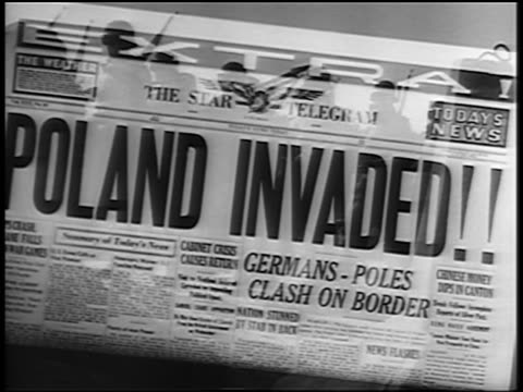 stockvideo's en b-roll-footage met close up newspaper headline: poland invaded! / german soldiers marching - nazism