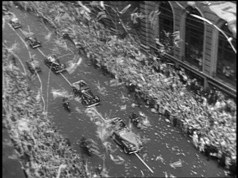 OVERHEAD cars driving in ticker tape parade at end of World War II on NYC street